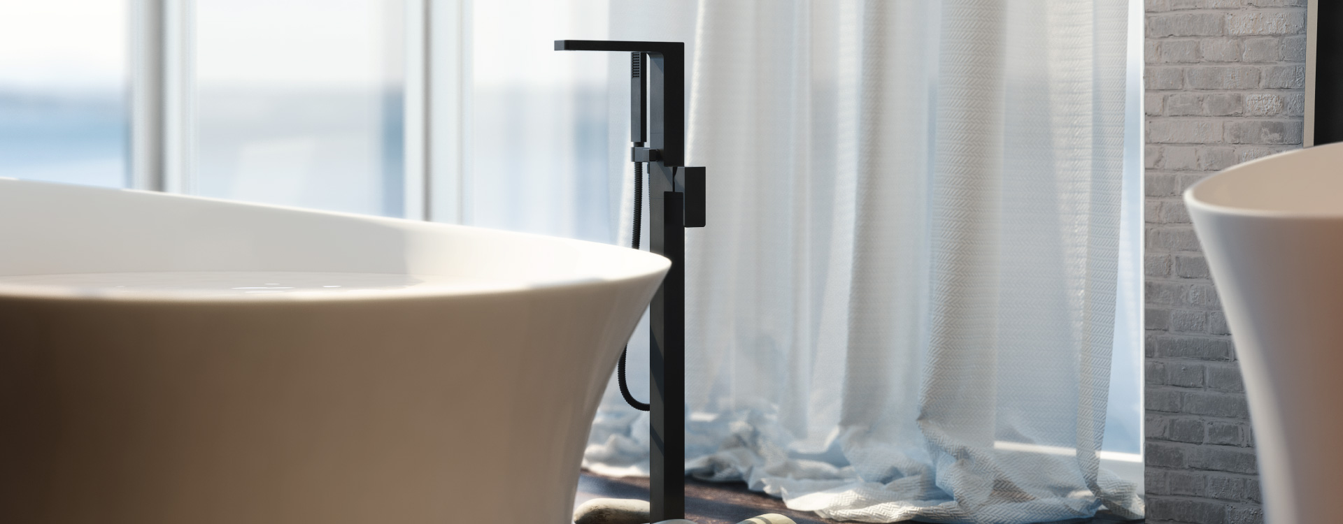 Freestanding Tub Faucet in Matte Black with white acrylic tub