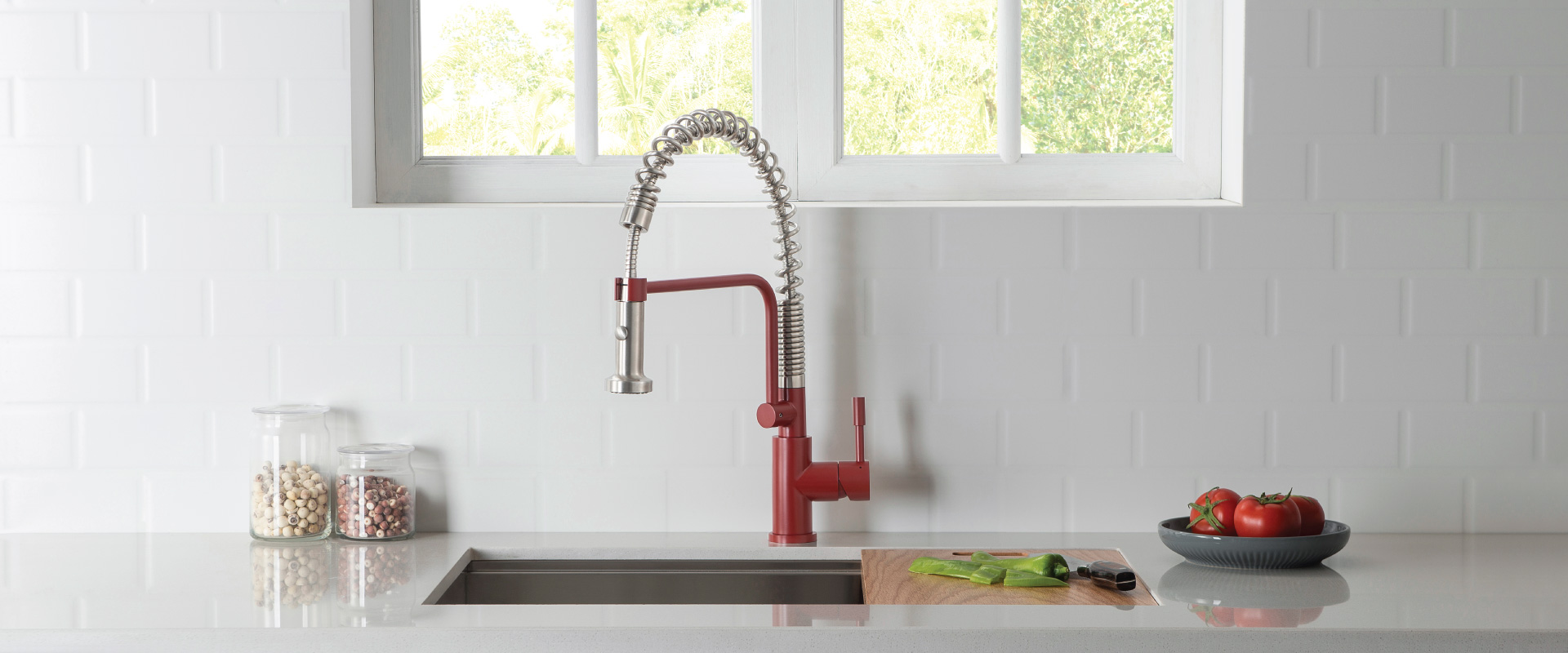 Red Kitchen Faucet with spring on white granite