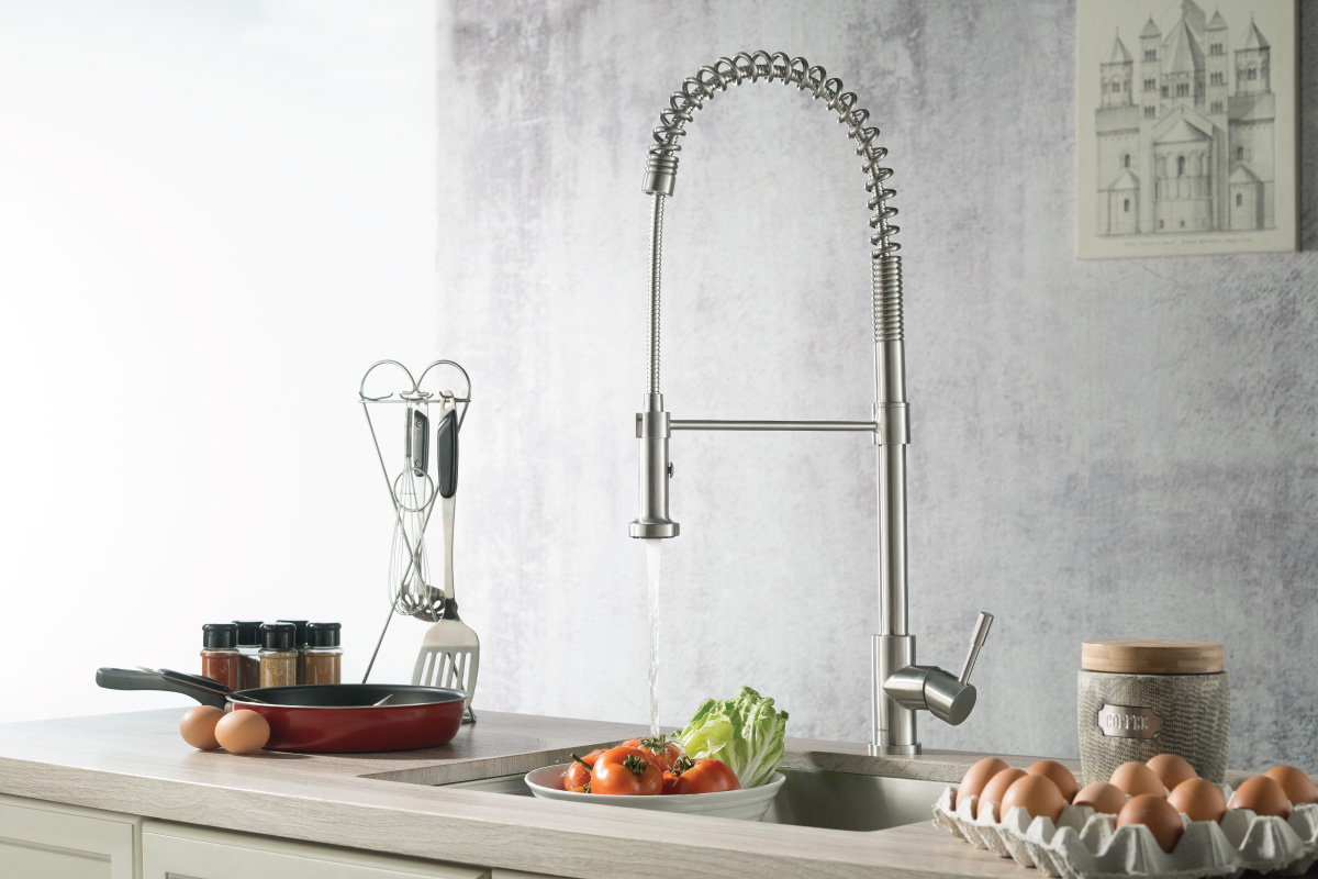 tall kitchen faucet on wood countertop