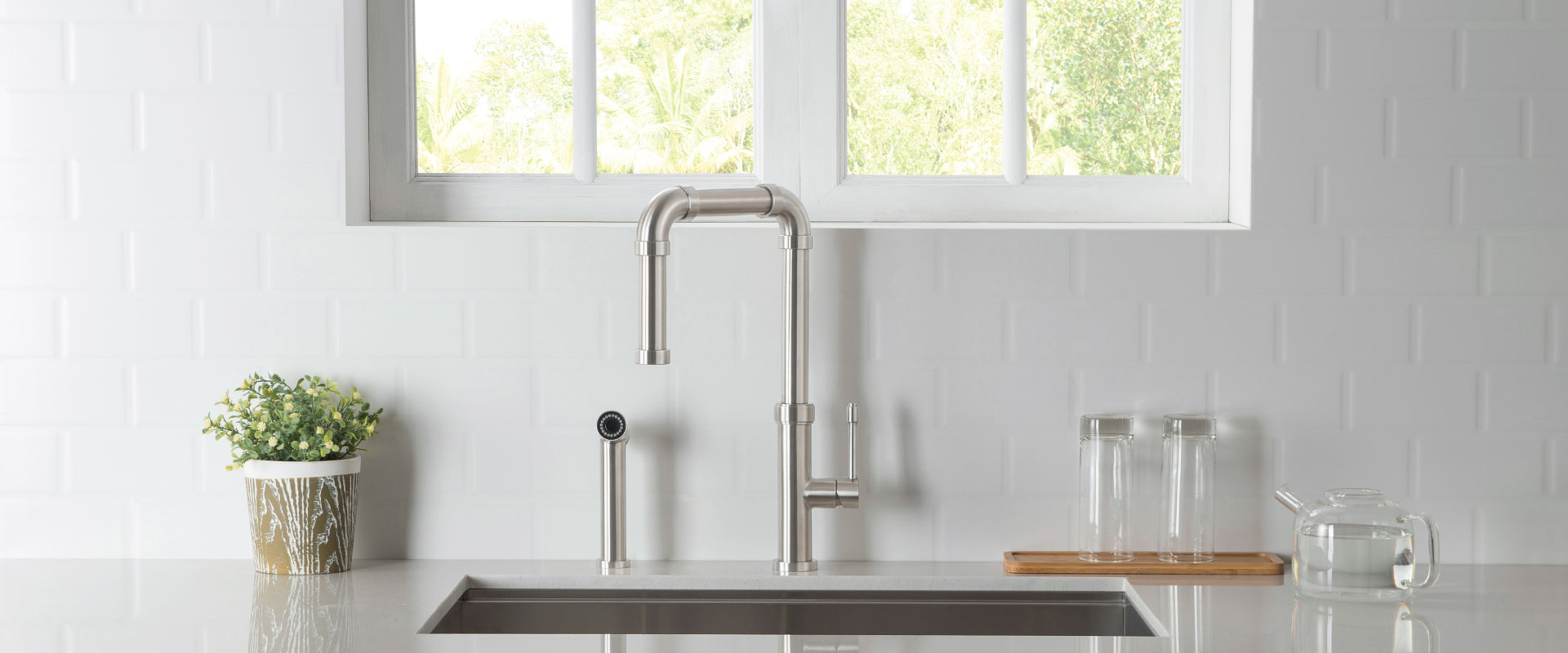 stainless steel kitchen faucet with side spray - white back splash