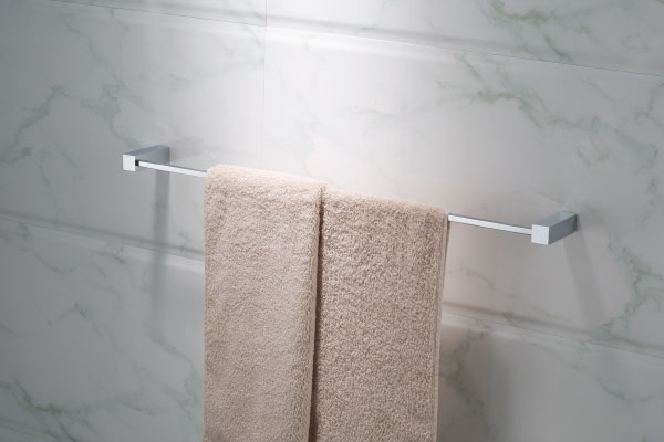 solid brass chrome towel bar on white marble