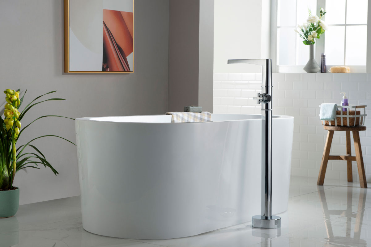 freestanding tub faucet in modern bathroom with white freestanding tub