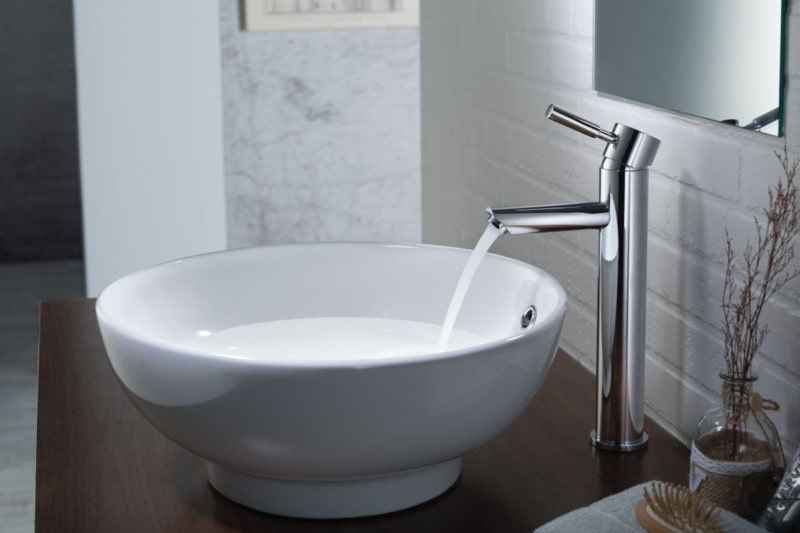 modern vessel faucet with white vanity