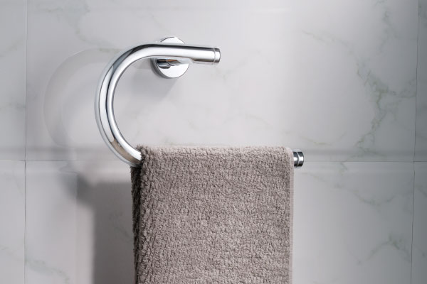 brass towel ring on white marble